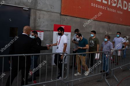 A large group of people waiting to vote for the new President of Sport Lisboa e Benfica , on October 9, 2021, at the Luz Stadium in Lisbon, Portugal.The Elections for the New President of Sport Lisboa e Benfica are held today. Former player Rui Costa is the main candidate and competes against Francisco Benitez.