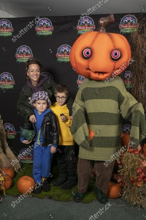 Stock Image of Jaime Winstone with husband James Suckling and children. Alton Towers Resort welcomed the first guests to enjoy the brand new spooktacular family attraction for this year's Scarefest, Trick O Treat Town, where every day is Halloween and the townsfolk favourite past time is trick-or-treating for the town's visitors.