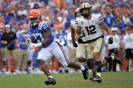 Florida running back Dameon Pierce (27) runs after catching a pass in front of Vanderbilt cornerback Jaylen Mahoney (23) and linebacker Brayden DeVault-Smith (12) for a 61-yard touchdown during the second half of an NCAA college football game, in Gainesville, Fla