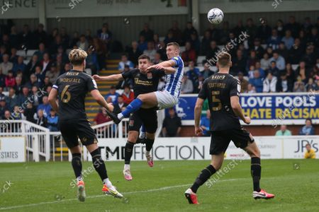 David Ferguson of Hartlepool United heads their first goal to make the score 1-1  during the Sky Bet League 2 match between Hartlepool United and Northampton Town at Victoria Park, Hartlepool on Saturday 9th October 2021.