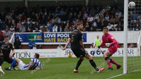 Hartlepool United's David Ferguson scores their first goal to lvel the score at 1-1  during the Sky Bet League 2 match between Hartlepool United and Northampton Town at Victoria Park, Hartlepool on Saturday 9th October 2021.