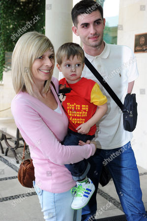 Fiona Solomon holding her daughter Stacey's son Zachary Cox alongside friend Aaron Barham