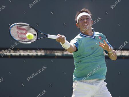 Kei Nishikori of Japan returns a shot against Dan Evans of Great Britain during the BNP Paribas Open at Indian Wells Tennis Garden in Indian Wells, California. Mandatory Photo Credit : Charles Baus/CSM