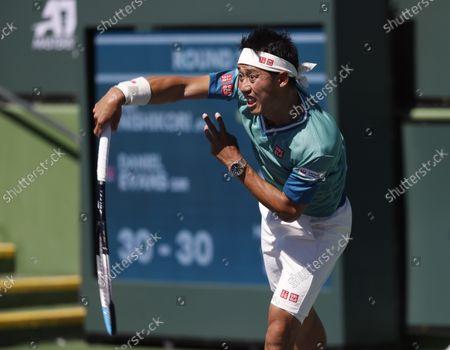 Kei Nishikori of Japan serves against Dan Evans of Great Britain during the BNP Paribas Open at Indian Wells Tennis Garden in Indian Wells, California. Mandatory Photo Credit : Charles Baus/CSM