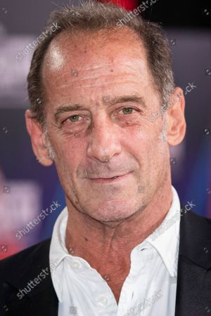 Vincent Lindon poses for photographers upon arrival at the premiere of the film 'Titane' during the 2021 BFI London Film Festival in London