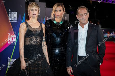 Agathe Rousselle, from left, Julia Ducournau and Vincent Lindon pose for photographers upon arrival at the premiere of the film 'Titane' during the 2021 BFI London Film Festival in London