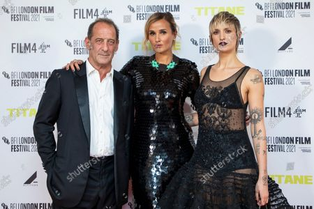 Vincent Lindon, from left, Julia Ducournau and Agathe Rousselle pose for photographers upon arrival at the premiere of the film 'Titane' during the 2021 BFI London Film Festival in London