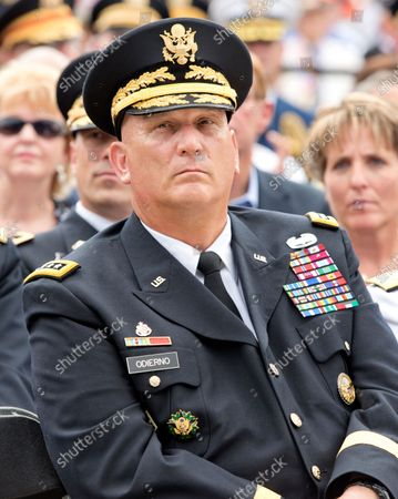 """Stock Photo of United States Army General Raymond T. """"Ray"""" Odierno, Chief of Staff of the Army, listens as United States President Barack Obama delivers remarks marking the 60th Anniversary of the Korean War Armistice at the Korean War Veterans Memorial in Washington, D.C.."""