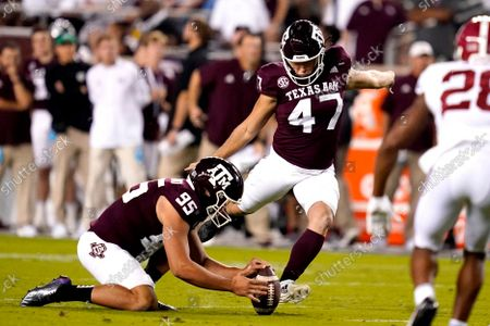 Texas A&M place kicker Seth Small (47) makes a 38-yard field goal against Alabama as punter Nik Constantinou (95) spots the ball during the first quarter of an NCAA college football game, in College Station, Texas