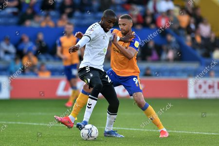 Stock Picture of Oldham Athletic's Dylan Bahamboula tussles with Jordan Bowery of Mansfield Town during the Sky Bet League 2 match between Mansfield Town and Oldham Athletic at the One Call Stadium, Mansfield on Saturday 9th October 2021.