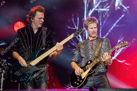 John Taylor (L) and Dominic Brown of Duran Duran perform