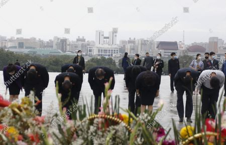 Citizens pay tribute to North Korean leaders Kim Il Sung and Kim Jong Il in front of the statues on the occasion of the 76th founding anniversary of the Worker's Party in Pyongyang, North Korea