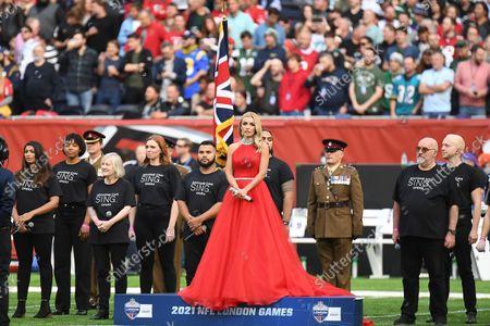 Katherine Jenkins prepares to sing the National anthem during the International Series match between New York Jets and Atalanta Falcons at Tottenham Hotspur Stadium, London