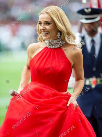 Opera Singer Katherine Jenkins leaves the field after singing the Nation anthem before the game between the Atlanta Falcons and the New York Jets
