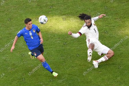Giacomo Raspadori (L) of Italy in action against Jason Denayer (R) of Belgium during the UEFA Nations League third place soccer match between Italy and Belgium in Turin, Italy, 10 October 2021.