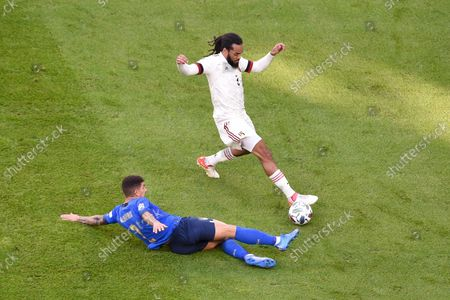 Giovanni Di Lorenzo (L) of Italy in action against Jason Denayer (R) of Belgium during the UEFA Nations League third place soccer match between Italy and Belgium in Turin, Italy, 10 October 2021.