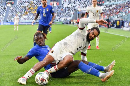 Jason Denayer (R) of Belgium in action against Moise Kean (L) of Italy during the UEFA Nations League third place soccer match between Italy and Belgium in Turin, Italy, 10 October 2021.