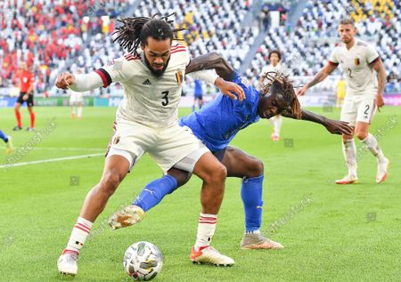 Jason Denayer (L) of Belgium in action against Moise Kean (R) of Italy during the UEFA Nations League third place soccer match between Italy and Belgium in Turin, Italy, 10 October 2021.
