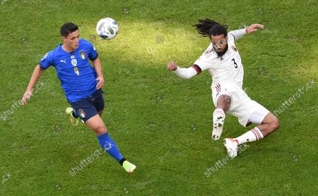Belgium's Jason Denayer, right, challenges for the ball with Italy's Giacomo Raspadori during the UEFA Nations League third place soccer match between Italy and Belgium at the Juventus stadium, in Turin, Italy