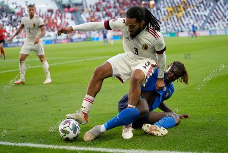 Belgium's Jason Denayer, left, challenges for the ball with Italy's Moise Kean during the UEFA Nations League third place soccer match between Italy and Belgium at the Juventus stadium, in Turin, Italy