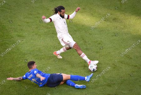 Italy's Giovanni Di Lorenzo, left, challenges for the ball with Belgium's Jason Denayer during the UEFA Nations League third place soccer match between Italy and Belgium at the Juventus stadium, in Turin, Italy