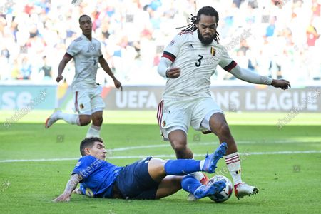 Stock Picture of Italian Giovanni Di Lorenzo and Belgium's Jason Denayer fight for the ball during a soccer game between Belgian national team Red Devils and Italy, the Nations League third-place play-off, in Torino, Italy, on Sunday 10 October 2021.