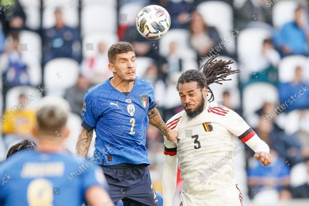 Italian Giovanni Di Lorenzo and Belgium's Jason Denayer fight for the ball during a soccer game between Belgian national team Red Devils and Italy, the Nations League third-place play-off, in Torino, Italy, on Sunday 10 October 2021.