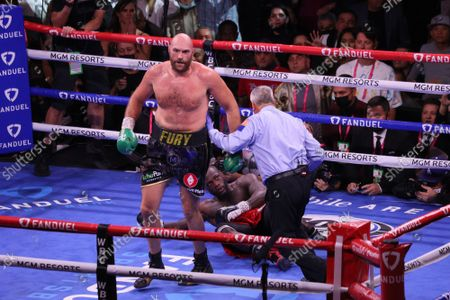 Tyson Fury knocks down Deontay Wilder with a right to the head in the 3rd round of the Tyson Fury vs Deontay Wilder III 12-round Heavyweight boxing match, at the T-Mobile Arena in Las Vegas, Nevada on Saturday, October 9th, 2021.