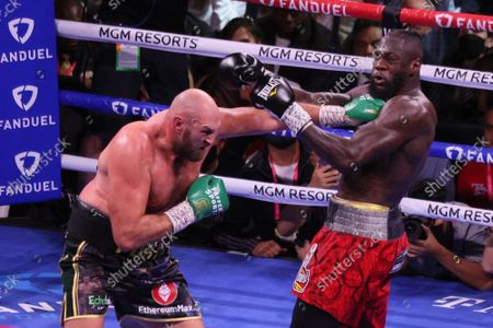 Tyson Fury lands a left jab to Deontay Wilderâ€s chest during  the Tyson Fury vs Deontay Wilder III 12-round Heavyweight boxing match, at the T-Mobile Arena in Las Vegas, Nevada on Saturday, October 9th, 2021.