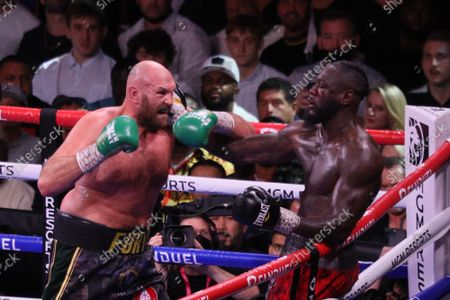 Tyson Fury attempts to land a punch while Deontay Wilder leans against the ropes during the Tyson Fury vs Deontay Wilder III 12-round Heavyweight boxing match, at the T-Mobile Arena in Las Vegas, Nevada on Saturday, October 9th, 2021.