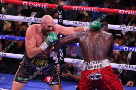 Tyson Fury and Deontay Wilder throw simultaneous jabs during the Tyson Fury vs Deontay Wilder III 12-round Heavyweight boxing match, at the T-Mobile Arena in Las Vegas, Nevada on Saturday, October 9th, 2021.