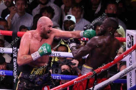 Deontay Wilder (right) evades a left jab by Tyson Fury during the Tyson Fury vs Deontay Wilder III 12-round Heavyweight boxing match, at the T-Mobile Arena in Las Vegas, Nevada on Saturday, October 9th, 2021.