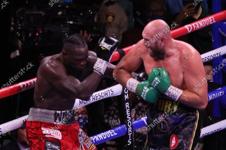 Deontay Wilder reacts to a Tyson Fury punch during the Deontay Wilder during the Tyson Fury vs Deontay Wilder III 12-round Heavyweight boxing match, at the T-Mobile Arena in Las Vegas, Nevada on Saturday, October 9th, 2021.