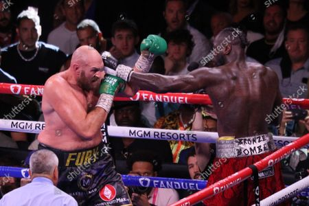 Deontay Wilder throws a jab to defend against Tyson Fury during the Tyson Fury vs Deontay Wilder III 12-round Heavyweight boxing match, at the T-Mobile Arena in Las Vegas, Nevada on Saturday, October 9th, 2021.