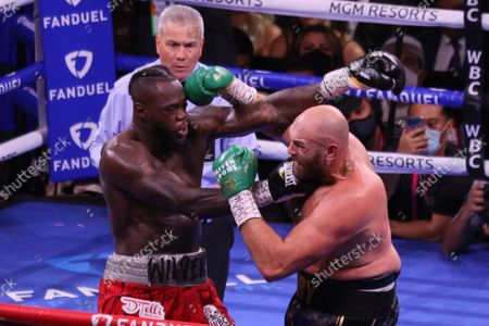 Deontay Wilder and Tyson Fury exchange punches during the Tyson Fury vs Deontay Wilder III 12-round Heavyweight boxing match, at the T-Mobile Arena in Las Vegas, Nevada on Saturday, October 9th, 2021.