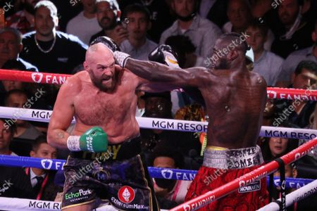 Tyson Fury (left) and Deontay Wilder exchange blows in the corner of the ring during the Tyson Fury vs Deontay Wilder III 12-round Heavyweight boxing match, at the T-Mobile Arena in Las Vegas, Nevada on Saturday, October 9th, 2021.