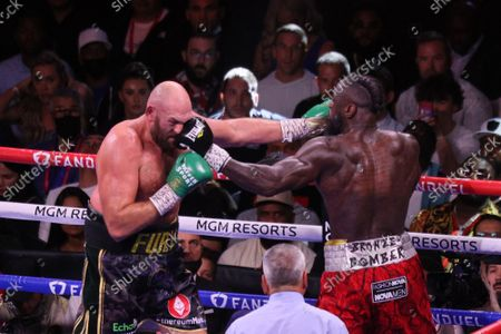 Tyson Fury and Deontay Wilder exchange left jabs in the corner of the ring during the Tyson Fury vs Deontay Wilder III 12-round Heavyweight boxing match, at the T-Mobile Arena in Las Vegas, Nevada on Saturday, October 9th, 2021.