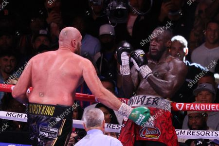 Tyson Fury forces Deontay Wilder against the ropes during the Tyson Fury vs Deontay Wilder III 12-round Heavyweight boxing match, at the T-Mobile Arena in Las Vegas, Nevada on Saturday, October 9th, 2021.