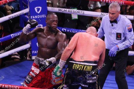 Deontay Wilder prepares to throw punch at Tyson Fury during the Tyson Fury vs Deontay Wilder III 12-round Heavyweight boxing match, at the T-Mobile Arena in Las Vegas, Nevada on Saturday, October 9th, 2021.