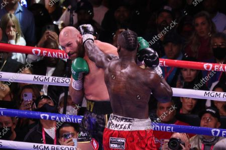 Stock Photo of Tyson Fury and Deontay Wilder throw glancing jabs at each other during the Tyson Fury vs Deontay Wilder III 12-round Heavyweight boxing match, at the T-Mobile Arena in Las Vegas, Nevada on Saturday, October 9th, 2021.