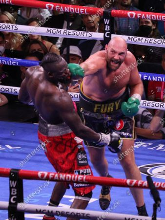 Tyson Fury lands a right punch on Deontay Wilder's jaw during the Tyson Fury vs Deontay Wilder III 12-round Heavyweight boxing match, at the T-Mobile Arena in Las Vegas, Nevada on Saturday, October 9th, 2021.