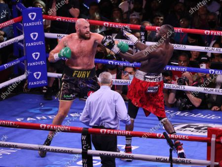 Tyson Fury (left) exchanges blows with Deontay Wilder during the Tyson Fury vs Deontay Wilder III 12-round Heavyweight boxing match, at the T-Mobile Arena in Las Vegas, Nevada on Saturday, October 9th, 2021.