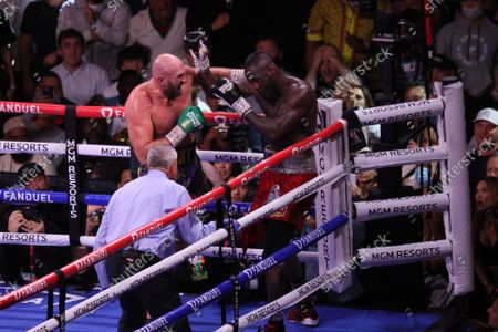 Tyson Fury lands a combination of punches on Deontay Wilder during the Tyson Fury vs Deontay Wilder III 12-round Heavyweight boxing match, at the T-Mobile Arena in Las Vegas, Nevada on Saturday, October 9th, 2021.