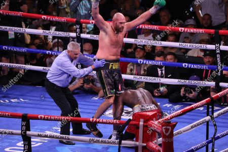 Tyson Fury celebrates after knocking down Deontay Wilder in the 10th round of the Tyson Fury vs Deontay Wilder III 12-round Heavyweight boxing match, at the T-Mobile Arena in Las Vegas, Nevada on Saturday, October 9th, 2021.