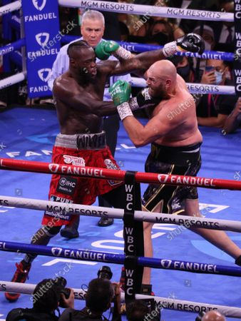 Deontay Wilder (left) and Tyson Fury exchange punches during the Tyson Fury vs Deontay Wilder III 12-round Heavyweight boxing match, at the T-Mobile Arena in Las Vegas, Nevada on Saturday, October 9th, 2021.