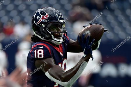 Houston Texans wide receiver Chris Conley warms up before an NFL football game against the New England Patriots, in Houston