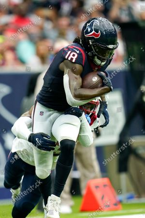 Houston Texans wide receiver Chris Conley (18) carries the ball after a reception during an NFL football game against the New England Patriots, in Houston
