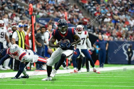 Houston Texans wide receiver Chris Conley (18) runs with the ball against the New England Patriots during the first half of an NFL football game, in Houston