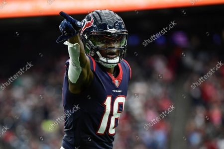 Houston Texans wide receiver Chris Conley (18) reacts to getting a first down after being tackled in the red zone against the New England Patriots during the first half of an NFL football game, in Houston