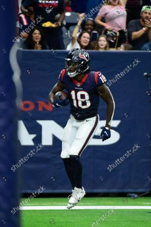 Houston Texans wide receiver Chris Conley (18) celebrates a touchdown against the New England Patriots during the second half of an NFL football game, in Houston